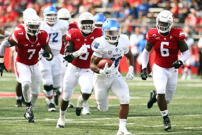 Buffalo Bulls running back Jaret Patterson is chased by three Rutgers Scarlet Knights defenders on his way to a first-half touchdown during a 2018 matchup at HighPoint.com Stadium in Piscataway, NJ.