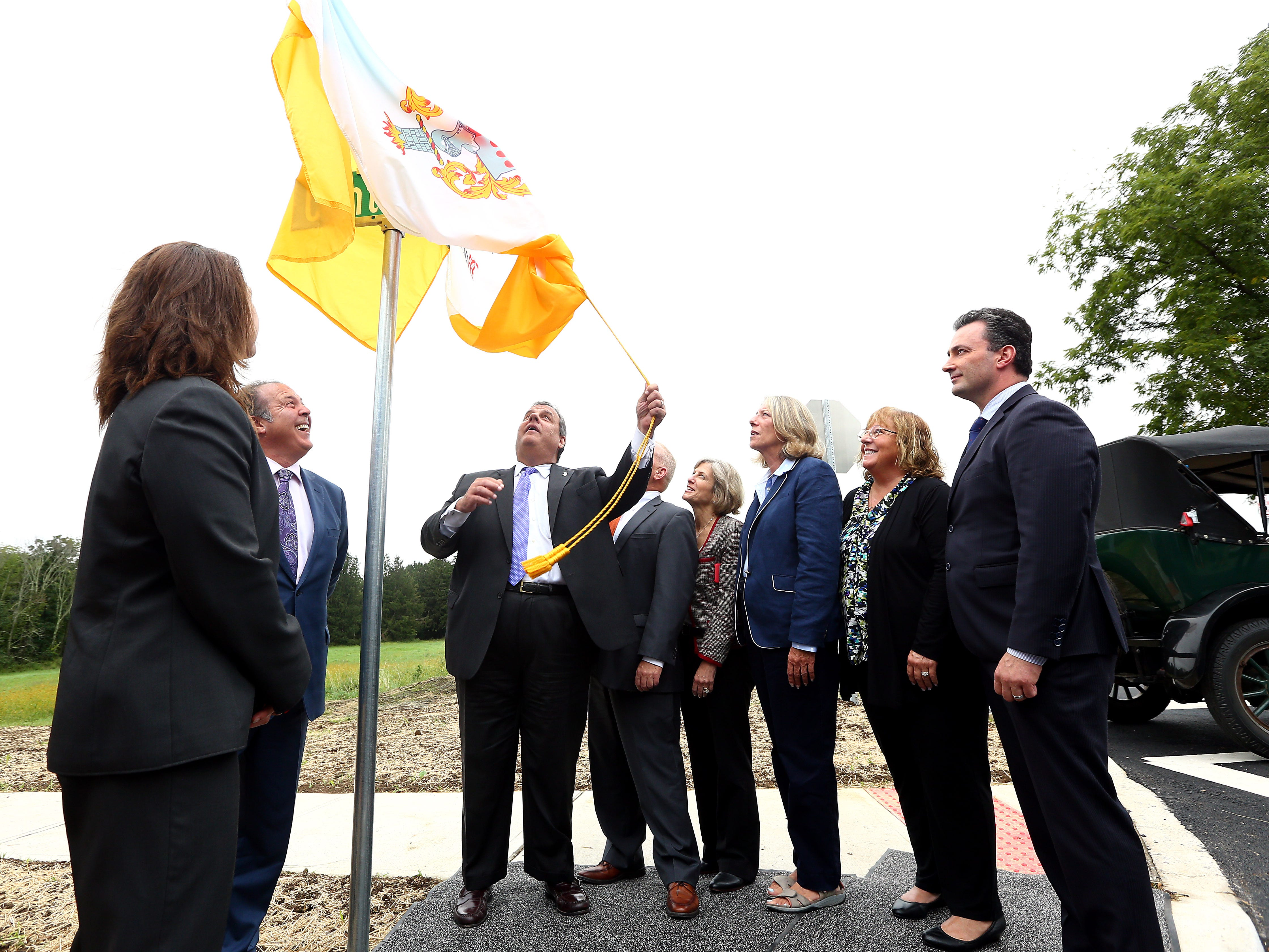 Former New Jersey Governor Chris Christie unveils the street sign as Morris County freeholders formally open Gov. Chris Christie Drive, a new main access road to Central Park of Morris County. September 12, 2018, Morris Plains, NJ