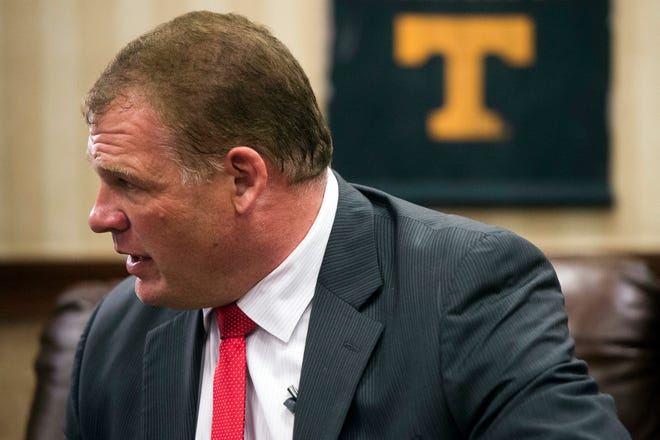 """FILE - In this Aug. 2, 2018 file photo, Republican Glenn Jacobs waits for early results to come in for the mayoral race in Knoxville, Tenn.  The Tennessee mayor will once again don his """"Kane"""" gear to participate in the WWE """"Super Show-Down"""" pay-per-view event in Australia. Jacobs said on Sept. 20,  the Oct. 6 event is what he and WWE CEO Vince McMahon agreed to when it became likely Jacobs would be elected."""