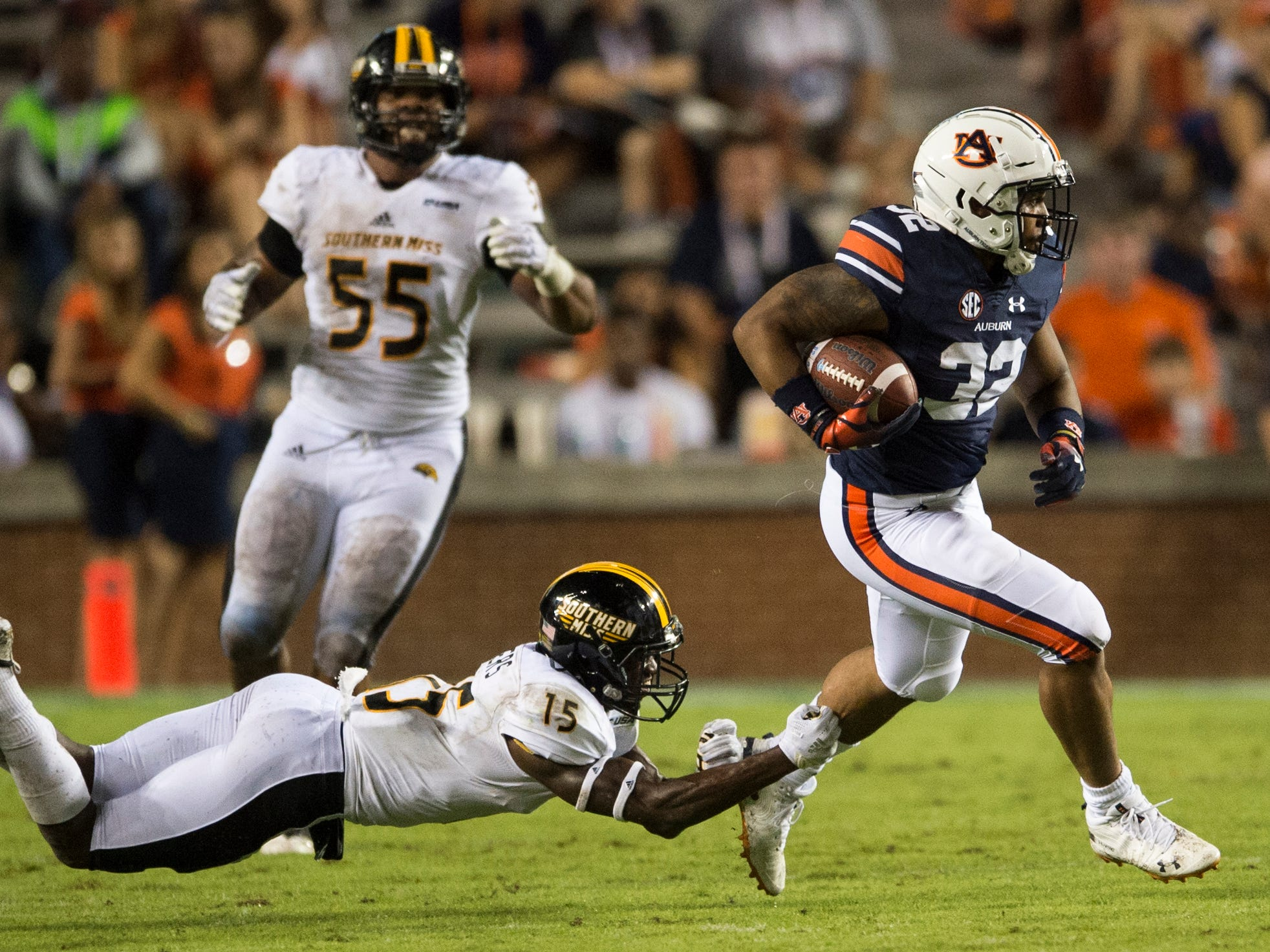 Auburn's Malik Miller (32) avoids Southern Miss' Shannon Showers (15) as he breaks a run at Jordan-Hare Stadium in Auburn, Ala., on Saturday, Sept. 29, 2018. Auburn defeated  Southern Miss 24-13.