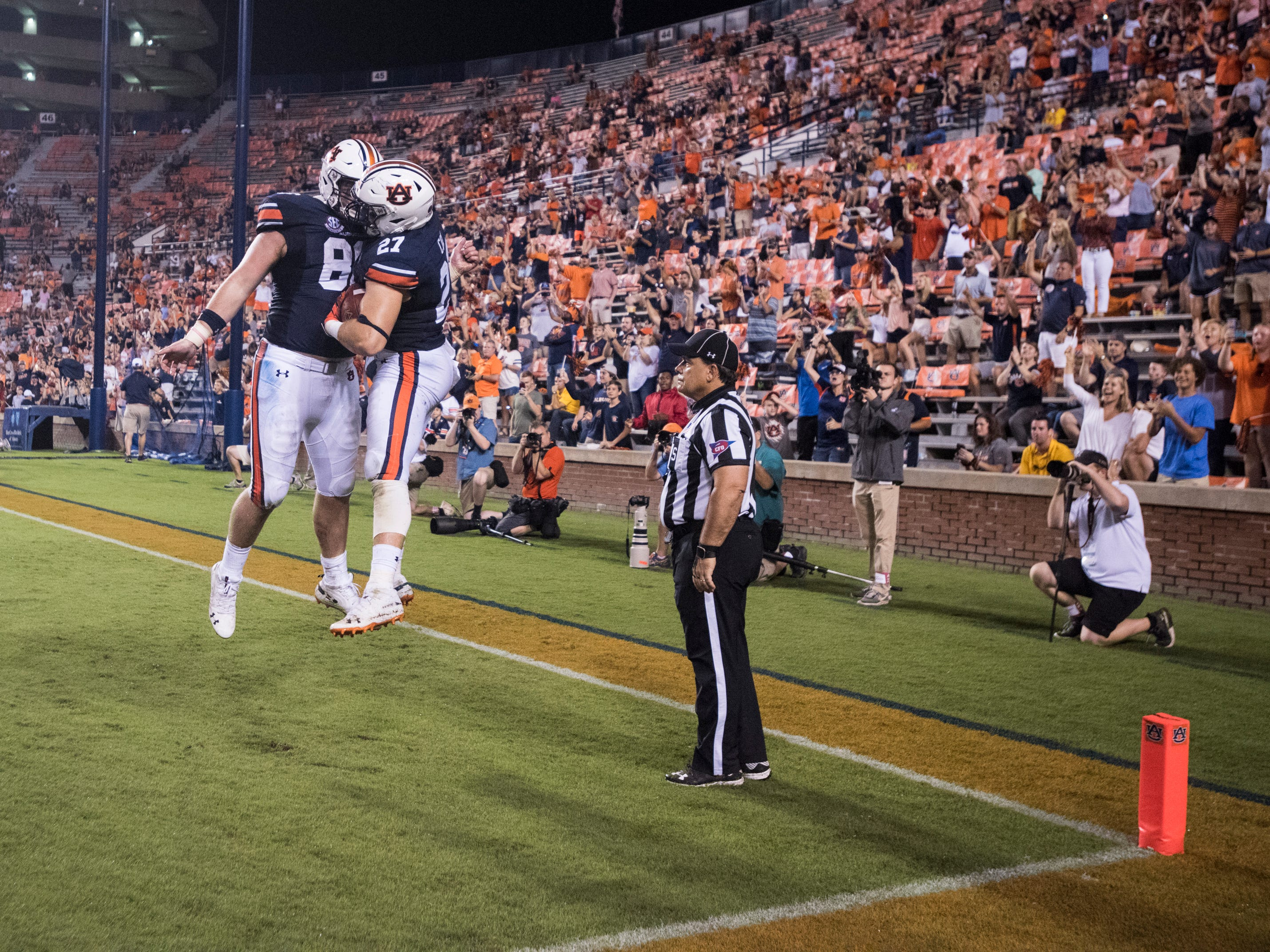 Auburn's Tucker Brown (86) and Chandler Cox (27) react after Cox's touchdown catch at Jordan-Hare Stadium in Auburn, Ala., on Saturday, Sept. 29, 2018. Auburn defeated  Southern Miss 24-13.