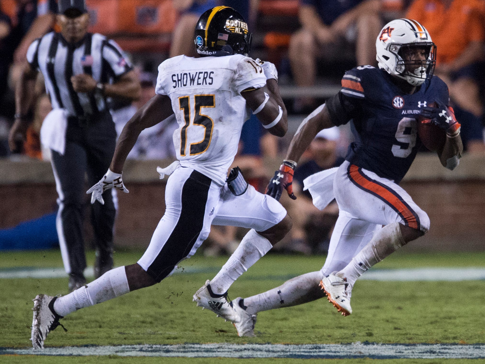 Auburn's Kam Martin (9) runs the ball chased by Southern Miss' Shannon Showers (15) at Jordan-Hare Stadium in Auburn, Ala., on Saturday, Sept. 29, 2018. Auburn defeated  Southern Miss 24-13.