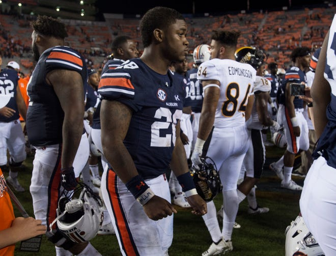 Auburn's JaTarvious Whitlow (28) is seen with no pads after the game at Jordan-Hare Stadium in Auburn, Ala., on Saturday, Sept. 29, 2018. Auburn defeated  Southern Miss 24-13. Whitlow left the game in the first half with an injury.