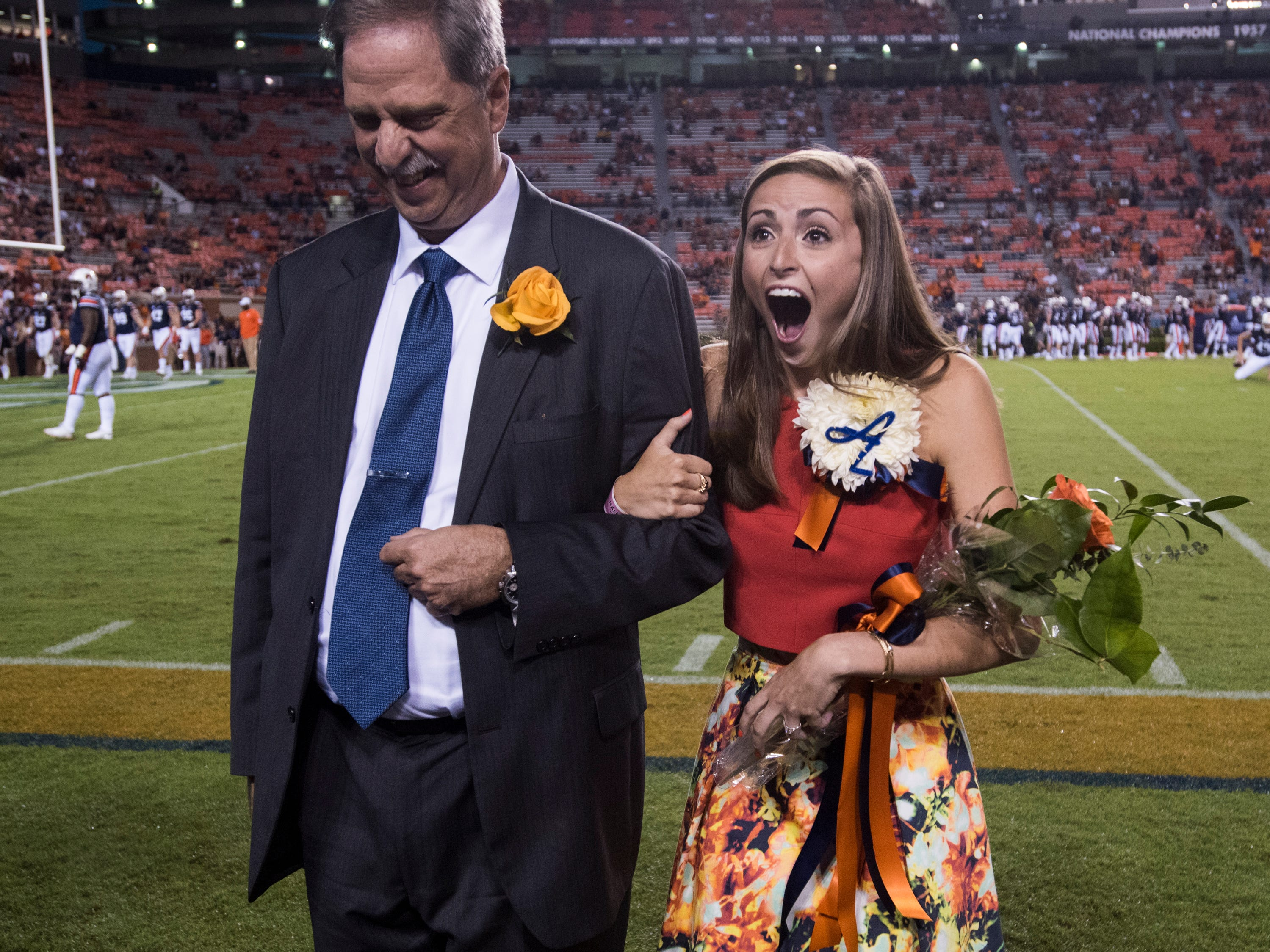 Sadie Argo, right, reacts after being announced homecoming queen at Jordan-Hare Stadium in Auburn, Ala., on Saturday, Sept. 29, 2018. Auburn defeated  Southern Miss 24-13.