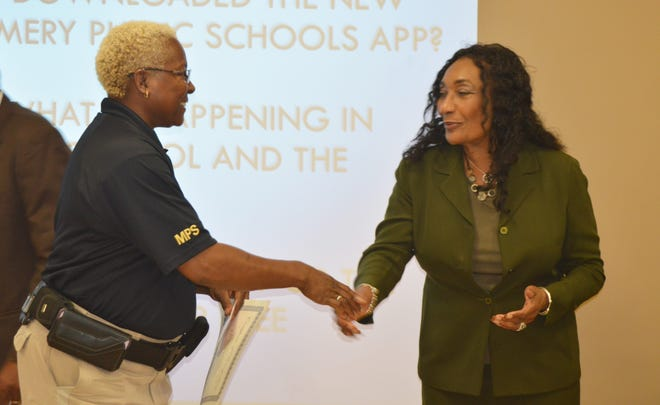 E.D. Nixon Elementary security officer Constance Griffin shakes hands with MPS Superintendent Ann Roy Moore during the Montgomery County Board of Education meeting on Tuesday.