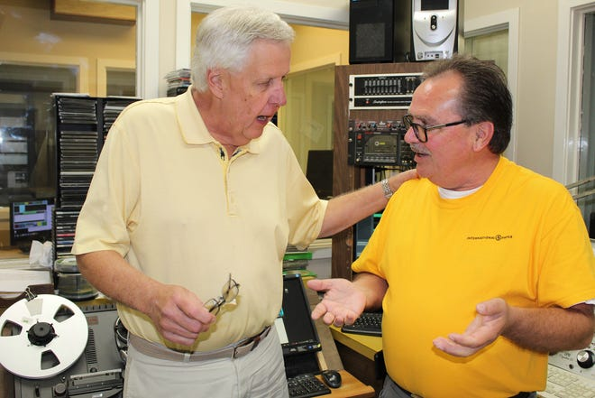 Broadcasters Mike Reynolds, left, and George Henry have an animated chat at their radio station in Selma.