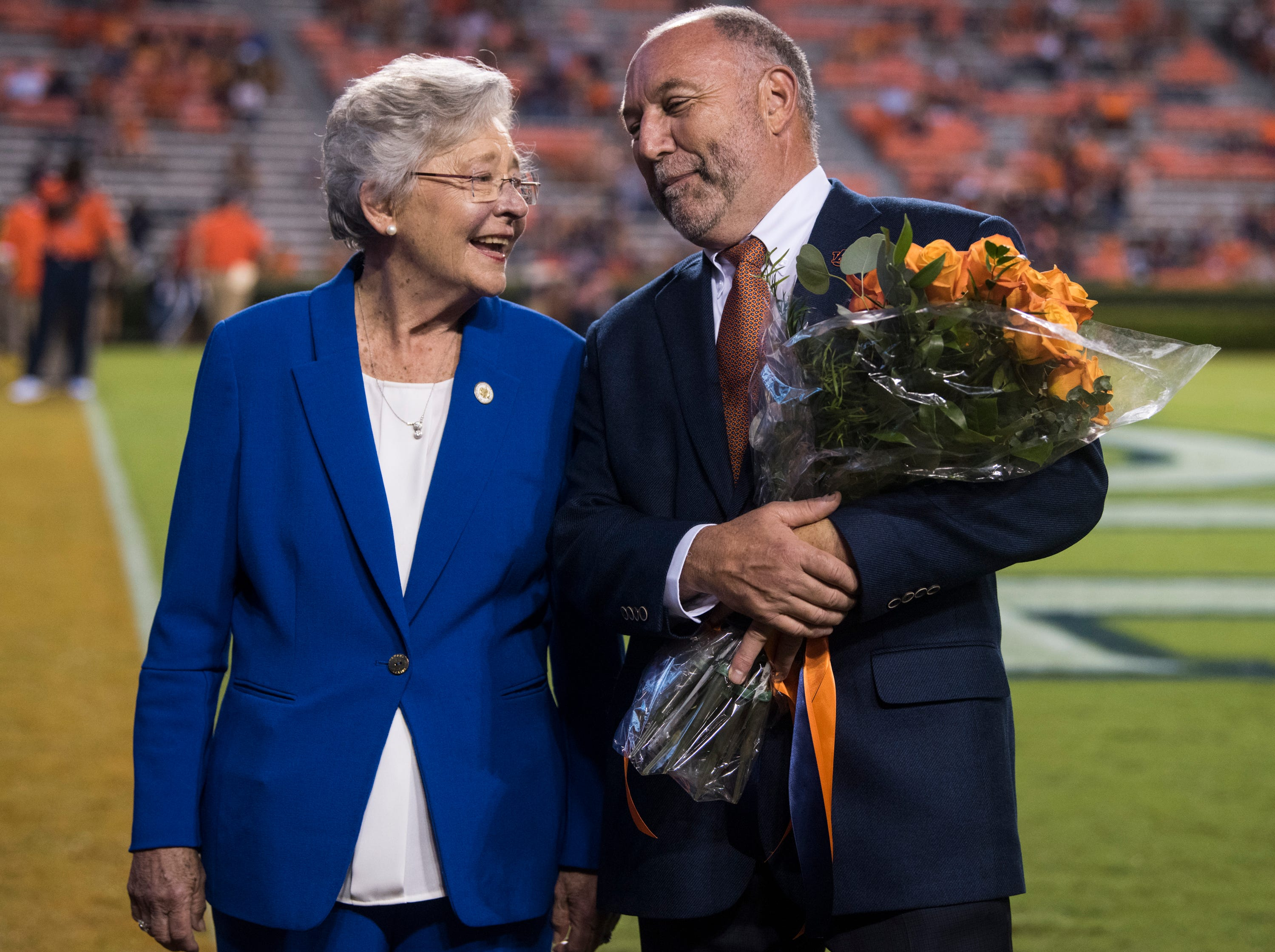 Alabama Gov. Kay Ivey and Auburn University President Steven Leath pose for a picture during the homecoming ceremony at Jordan-Hare Stadium in Auburn, Ala., on Saturday, Sept. 29, 2018. Auburn defeated  Southern Miss 24-13.