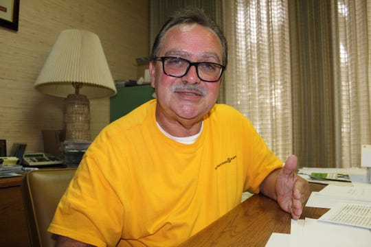 WHBB-AM Program Director George Henry spends much of his day at his busy desk in Selma.