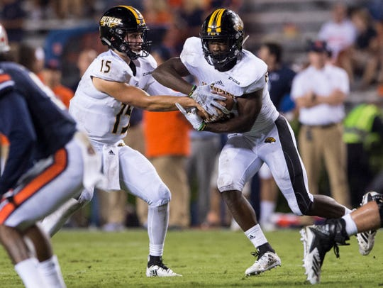 Southern Miss' Jack Abraham (15) hands the ball off to Southern Miss' Tez Parks (8) at Jordan-Hare Stadium in Auburn, Ala., on Saturday, Sept. 29, 2018. Auburn defeated  Southern Miss 24-13.