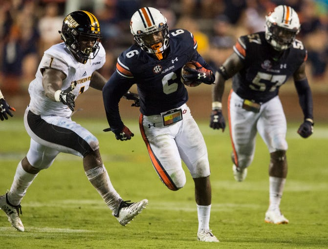 Auburn's Christian Tutt (6) returns the ball after getting a celebration at Jordan-Hare Stadium in Auburn, Ala., on Saturday, Sept. 29, 2018. Auburn defeated  Southern Miss 24-13.