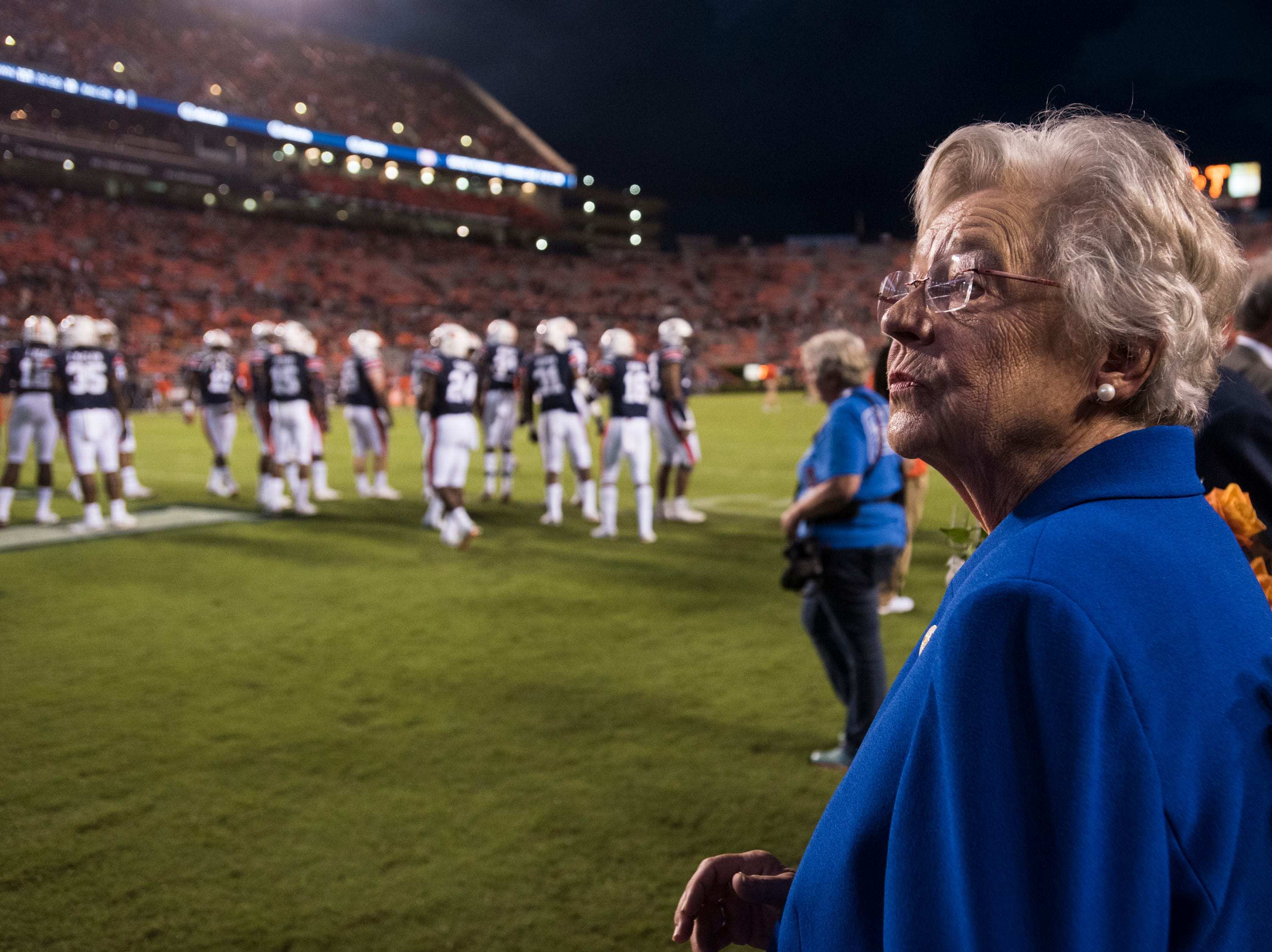 Alabama Gov. Kay Ivey watches as the Auburn players take the field following the weather delay at Jordan-Hare Stadium in Auburn, Ala., on Saturday, Sept. 29, 2018. Auburn defeated  Southern Miss 24-13.