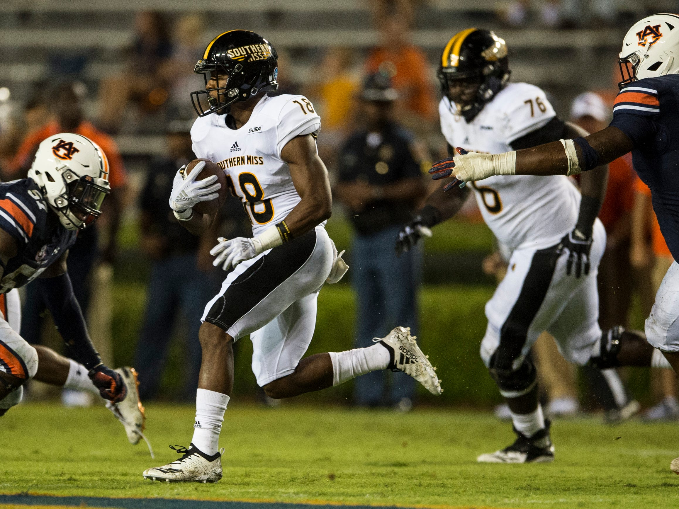 Southern Miss' Jason Goldstein (18) runs the ball down the field against  Auburn at Jordan-Hare Stadium in Auburn, Ala., on Saturday, Sept. 29, 2018. Auburn defeated  Southern Miss 24-13.