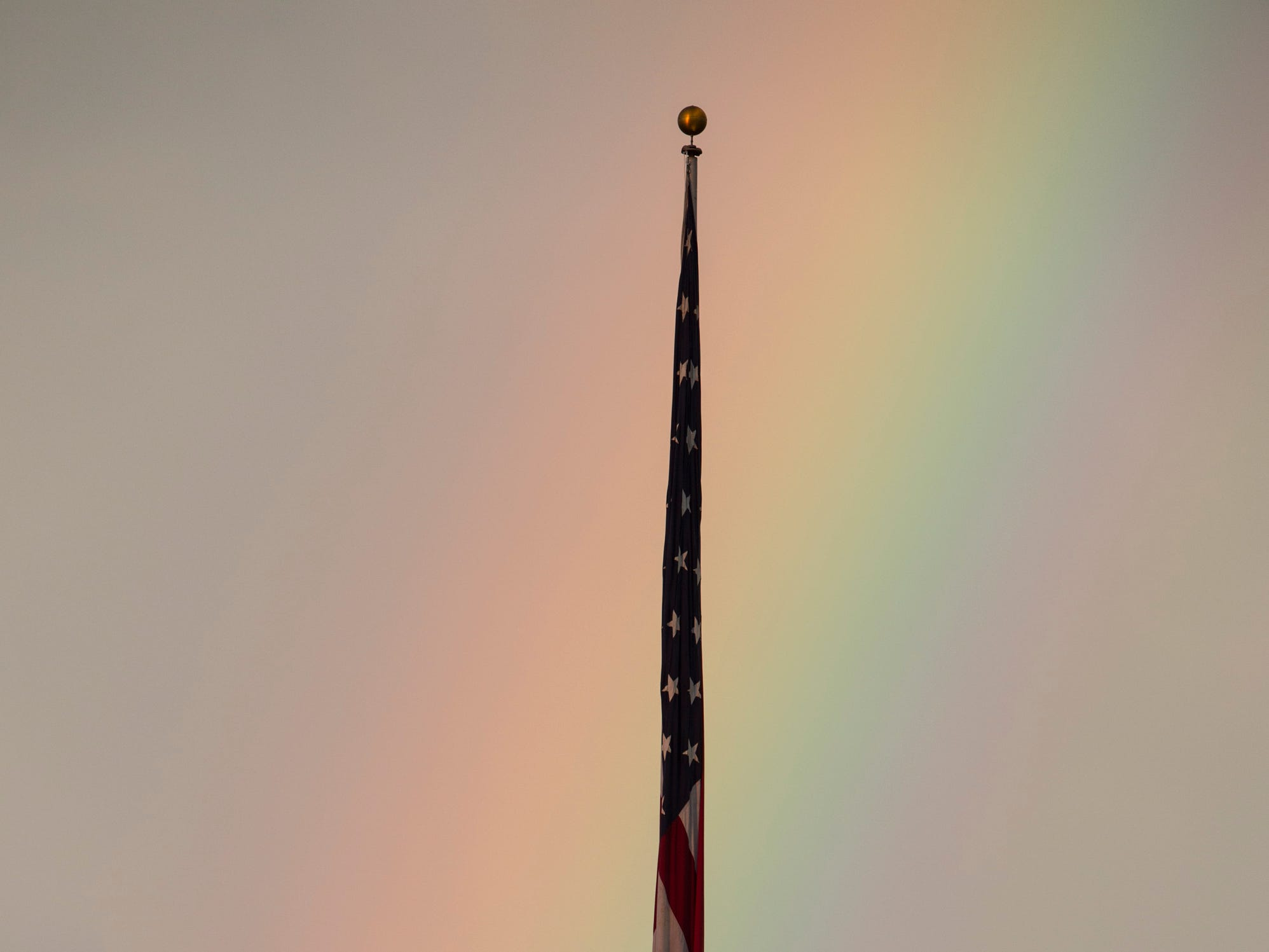 A rainbow is seen over the flag pole towards the end of the weather delay at Jordan-Hare Stadium in Auburn, Ala., on Saturday, Sept. 29, 2018. Auburn defeated  Southern Miss 24-13.