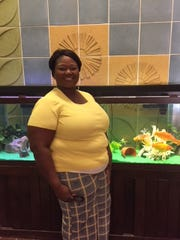 Parent liaison and teacher tutor Manervia Washington is shown in the lobby of Vaughn Road Elementary School.
