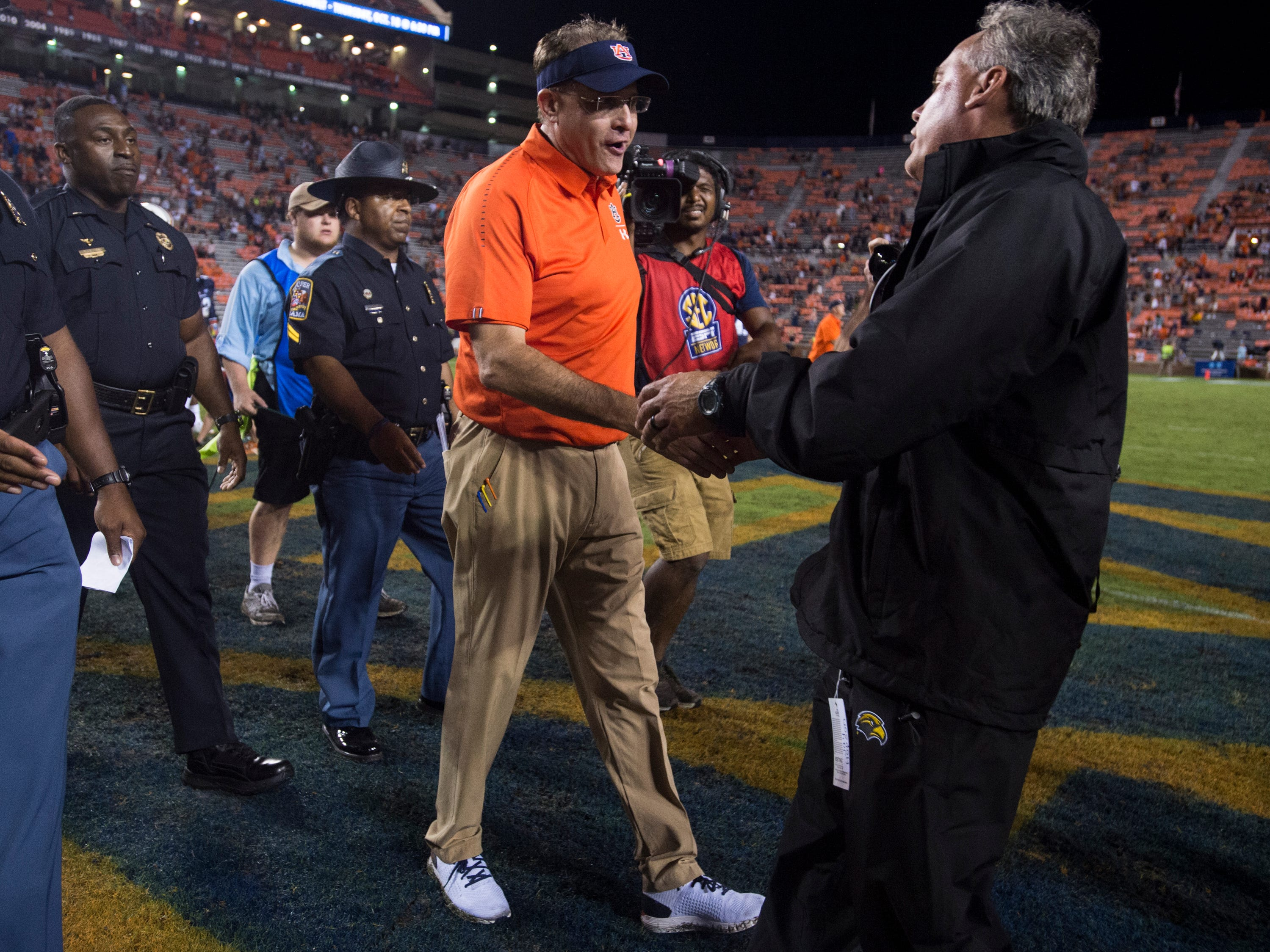 Auburn head coach Gus Malzahn shakes hands with Southern Miss head coach Jay Hopson following the game at Jordan-Hare Stadium in Auburn, Ala., on Saturday, Sept. 29, 2018. Auburn defeated  Southern Miss 24-13.