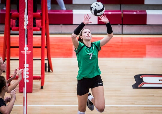 Yorktown's Kate Vinson sets against Wapahani's defense during their county championship game at Wapahani High School Saturday, Sept. 29, 2018.