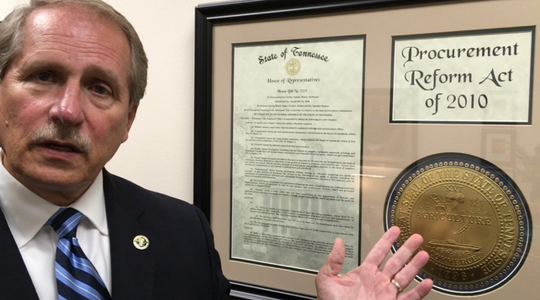 Rutherford County Mayor Bill  Ketron shows off a framed Procurement Act of 2010 document that he passed while he served in the Tennessee Senate.