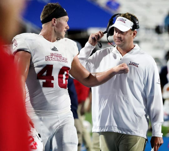FAU's head coach Lane Kiffen talks with Harrison Bryant (40) on the sidelines during the game against MTSU, at MTSU, on Saturday, Sept. 29, 2018.