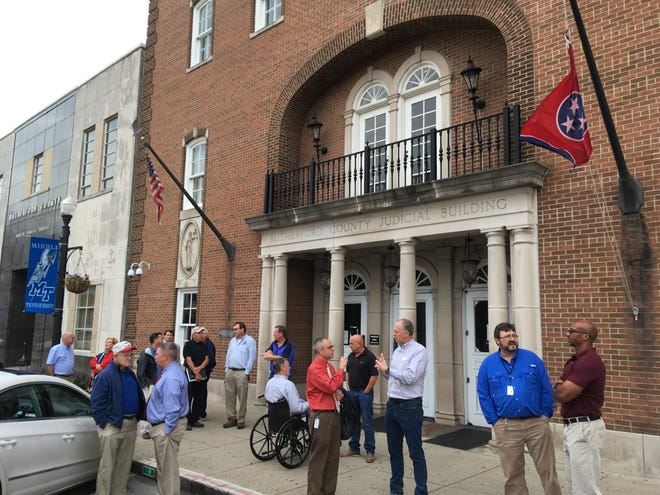 Rutherford County officials and consultants gather in front of the old Judicial Building after a tour to learn about renovation plans Sept. 27, 2018.