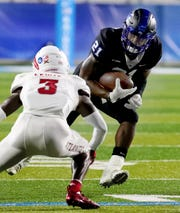 MTSU's Tavares Thomas (21) runs the ball as FAU's Shelton Lewis (3) moves in for a tackle during the game at MTSU on Saturday, Sept. 29, 2018.