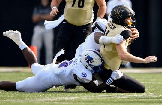 TSU linebacker Christion Abercrombie (6) tackles Vanderbilt quarterback Kyle Shurmur (14) during the first half at Vanderbilt Stadium in Nashville, Tenn., Saturday, Sept. 29, 2018.