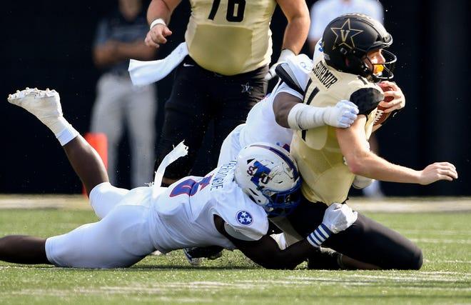 TSU linebacker Christion Abercrombie (6) tackles Vanderbilt quarterback Kyle Shurmur (14) during the first half Saturday.