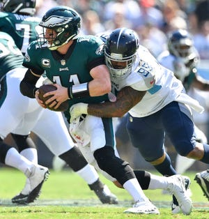 Titans defensive tackle Jurrell Casey (99) pressures Eagles quarterback Carson Wentz (11) in the second quarter at Nissan Stadium Sunday, Sept. 30, 2018, in Nashville, Tenn.