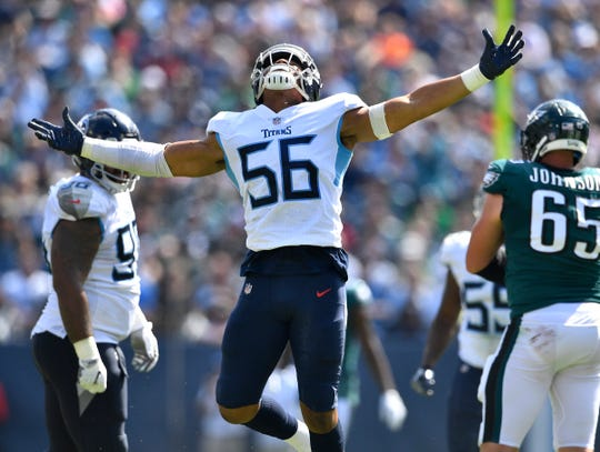 Titans linebacker Sharif Finch (56) celebrates his sack in the second quarter Sunday.