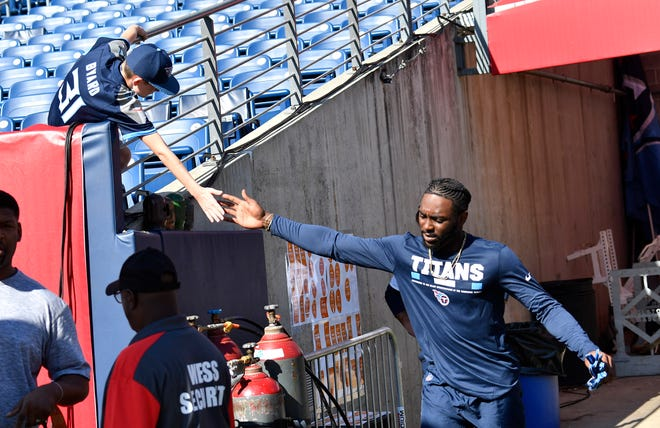 Titans wide receiver Taywan Taylor (13) slaps hands with a fan before the game against the Eagles at Nissan Stadium Sunday, Sept. 30, 2018, in Nashville, Tenn.