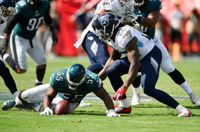 Titans running back Derrick Henry (22) tries to dive on a fumbled pitch against the Eagles on Sunday. The ball was recovered by Titans receiver Nick Williams.