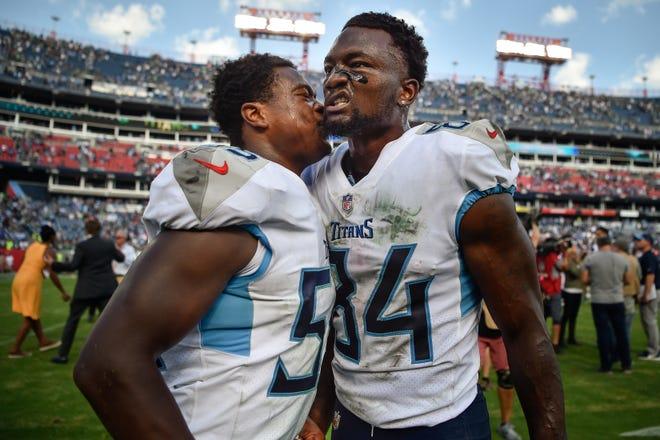 Titans wide receiver Corey Davis (84) celebrates with linebacker Jayon Brown (55) after Davis scored the game-winning touchdown Sunday.