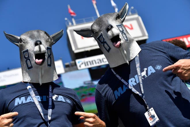Titans fans Drake and Chris Alsup show their favorites before the game against the Eagles at Nissan Stadium Sunday, Sept. 30, 2018, in Nashville, Tenn.