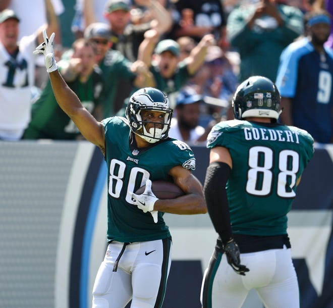 Eagles wide receiver Jordan Matthews (80) celebrates his touchdown with tight end Dallas Goedert (88) in the second quarter at Nissan Stadium Sunday, Sept. 30, 2018, in Nashville, Tenn.