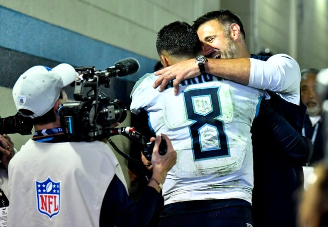 Titans coach Mike Vrabel and quarterback Marcus Mariota (8) celebrate the overtime win Sunday.