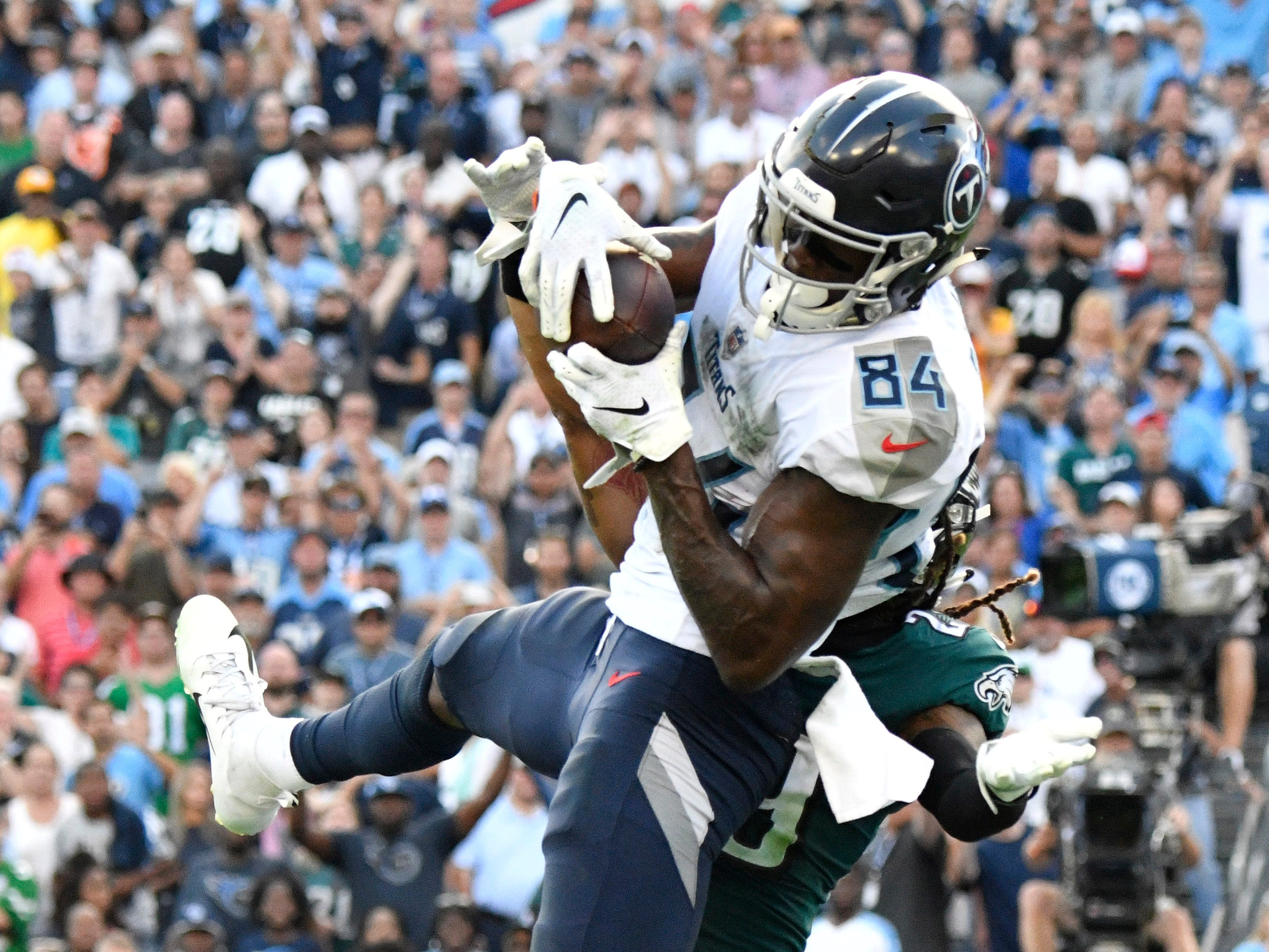 Titans wide receiver Corey Davis (84) makes the game-winning touchdown catch over Eagles cornerback Avonte Maddox (29) in overtime at Nissan Stadium Sunday, Sept. 30, 2018, in Nashville, Tenn.