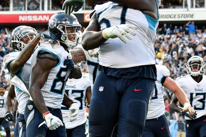 Tennessee Titans wide receiver Corey Davis (84) reacts after scoring the game winning touchdown against the Philadelphia Eagles in overtime at Nissan Stadium in Nashville, Tenn., Sunday, Sept. 30, 2018.