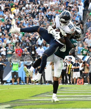 Titans wide receiver Corey Davis (84) makes the game-winning touchdown catch in overtime Sunday.