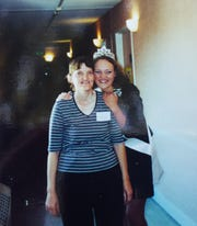 Penny Fisher, right, stands with her mother, Nancy Moore, in July 2001. Moore's hair was beginning to grow back after she underwent treatment for breast cancer.