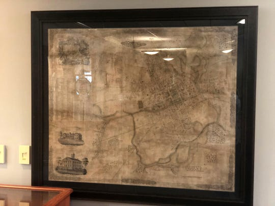 The historic item hung on the upper floor of the library is the first known map of Newark.
