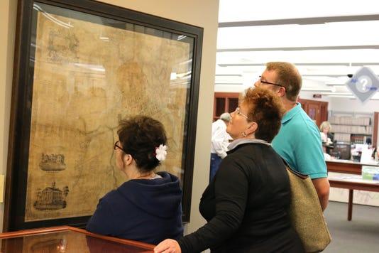 Patrons look at historic map