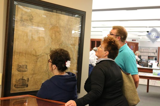 Patrons look at historic map