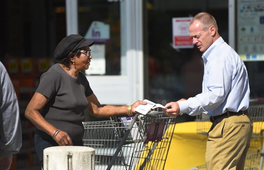 Kathy Kartofel of Paterson from The Love of Jesus Church, hands a flyer of the Food Drive to a shopper during a Food Drive at Stop & Shop in Wyckoff on 09/30/18.This is The RecordÕs 27th year supporting the Food Drive, which it founded based on reading one its own published articles about a local pantry with bare shelves.