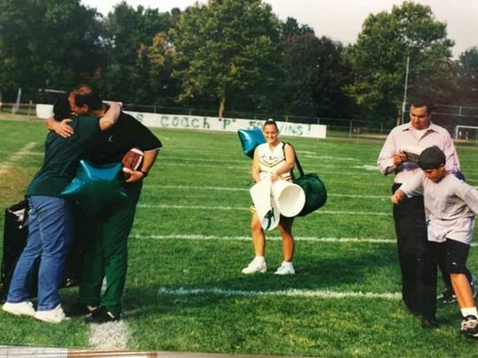 Chet Parlavecchio (left) after his 50th win as a high school football coach, which happened Sept. 27, 1997 during his first tenure at Passaic Valley.