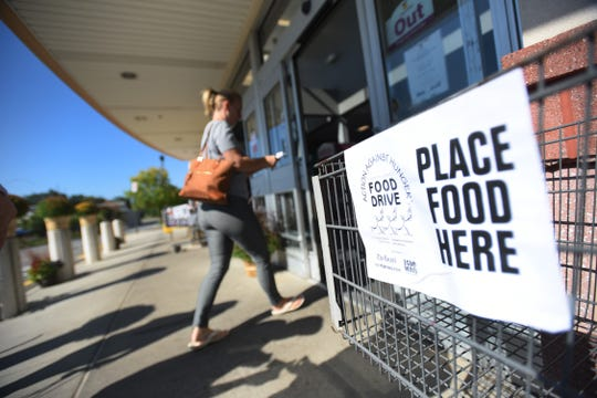 A shopper enters as the Food Drive sign is seen on a cart at the entrance of Stop & Shop in Wyckoff on 09/30/18. This is The RecordÕs 27th year supporting the Food Drive, which it founded based on reading one its own published articles about a local pantry with bare shelves.