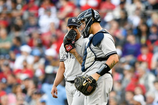Sep 30, 2018; Boston, MA, USA; New York Yankees pitcher Jonathan Loaisiga (38) talks with catcher Gary Sanchez (24) during the second inning against the Boston Red Sox at Fenway Park.