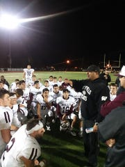 Wayne Hills offensive coordinator John Jacob congratulates the team after a 41-15 victory over West Milford.