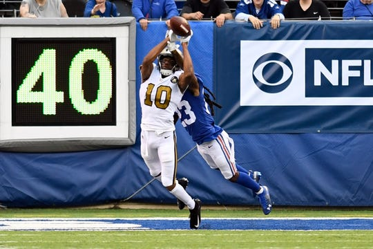 New Orleans Saints wide receiver Tre'Quan Smith (10) cannot complete a pass with pressure from New York Giants cornerback B.J. Webb (23) in the first half of an NFL game on Sunday, September 30, 2018 in East Rutherford, NJ.