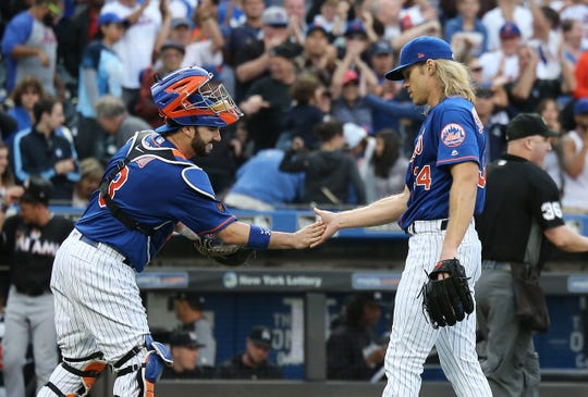 Sep 30, 2018; New York City, NY, USA; New York Mets starting pitcher Noah Syndergaard (34) is congratulated by catcher Tomas Nido (3) after pitching a complete game shutout against the Miami Marlins at Citi Field.