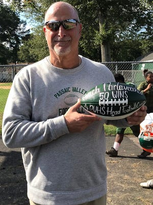 Passaic Valley football coach Chet Parlavecchio was honored after the win Sept. 29 with a ball commemorating his 50th victory at PV.