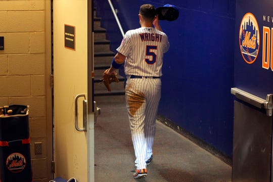 Sep 29, 2018; New York City, NY, USA; New York Mets third baseman David Wright (5) walks into the clubhouse after being taken out of the game during the fifth inning against the Miami Marlins at Citi Field.